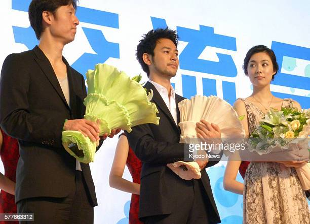 SHANGHAI China Film director Lee Sang Il actor Satoshi Tsumabuki and actress Kazue Fukiishi attend the opening ceremony of a Japan movie week in...