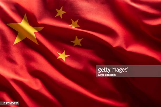 china flag blowing in the wind. - china east asia foto e immagini stock