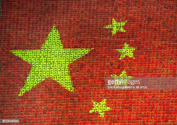 China flag made by children pixels holding up colored boards during Arirang mass games in may day stadium Pyongan Province Pyongyang North Korea on...