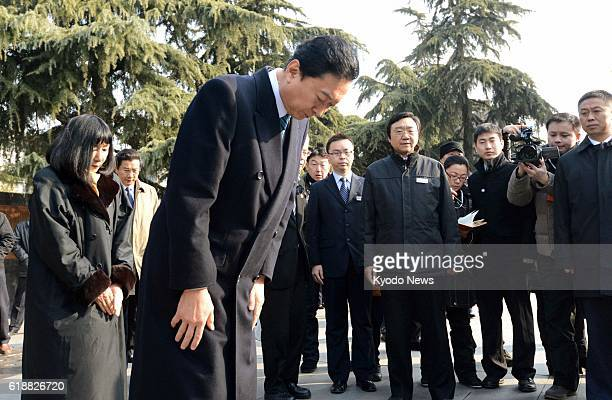 NANJING China Former Japanese Prime Minister Yukio Hatoyama lowers his head at a Nanjing Massacre memorial hall in Nanjing Jiangsu Province China on...