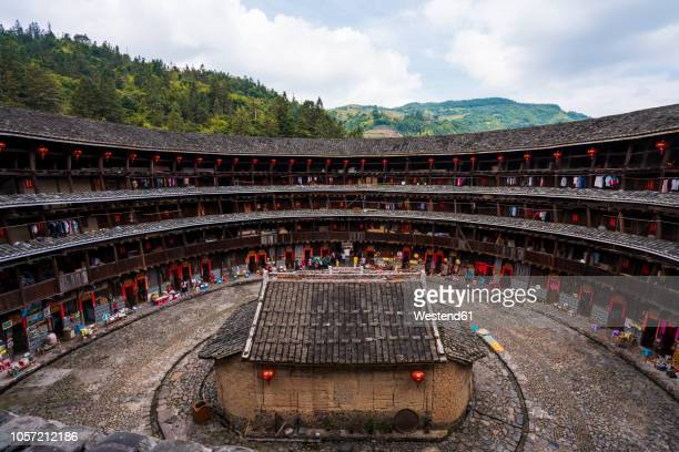 china, fujian province, inner courtyard of a tulou in a hakka village - fujian tulou stock pictures, royalty-free photos & images