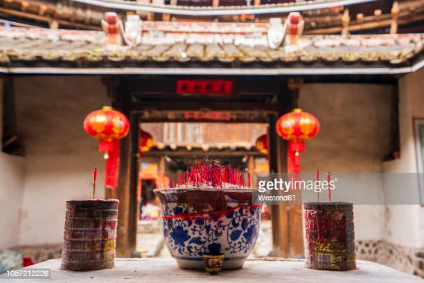 china, fujian province, joss sticks in a tulou in a hakka village - fujian tulou stock pictures, royalty-free photos & images