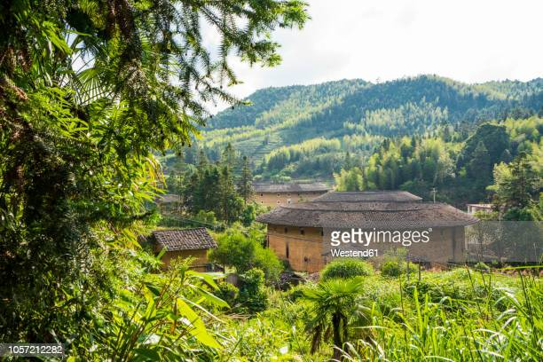 china, fujian province, tulou in a hakka village - fujian tulou stock pictures, royalty-free photos & images