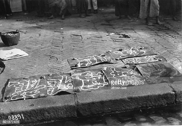 China good wishes for the New Year the ink of the paper drying on the street probably in the 1910s