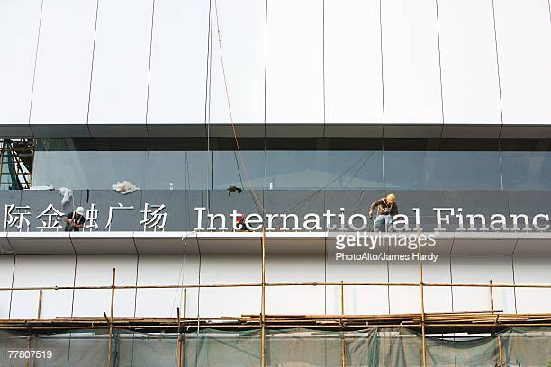 China, Guangdong Province, Guangzhou, office building under construction, close-up