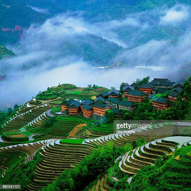 China, Guangxi Province, Guilin, Chinese town of Guilin on mountain side with terraced rice fields