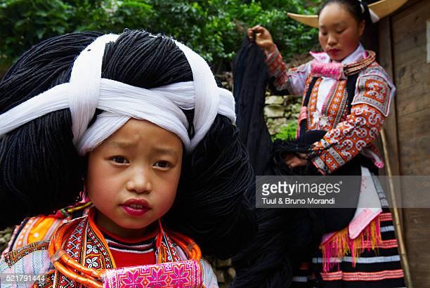 China, Guizhou province, Longjia village, Long Horn Miao girls in traditional costumes
