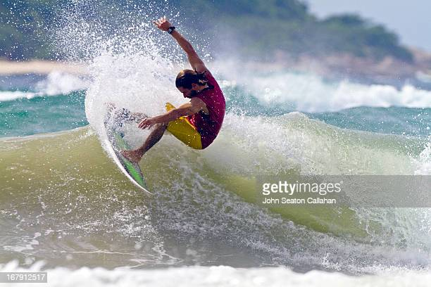 china, hainan island, surfing with erwan simon. - hainan island stock pictures, royalty-free photos & images