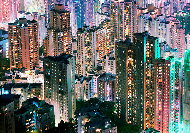 China, Hong Kong, apartment blocks at night