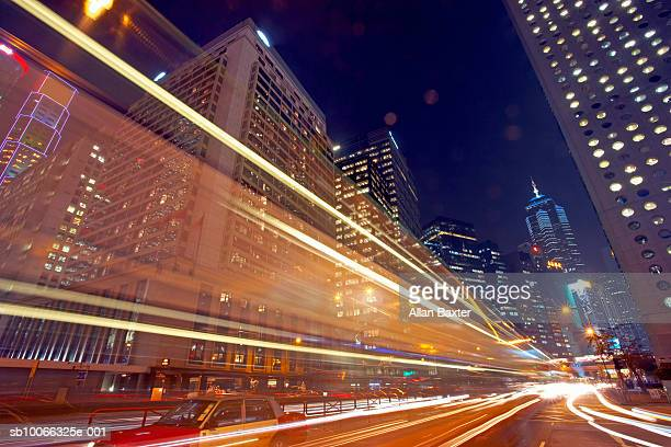 China, Hong Kong, blurred traffic lights in central district at night