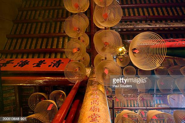 china, hong kong, coils of incense inside man mo temple - incense coils stock photos and pictures