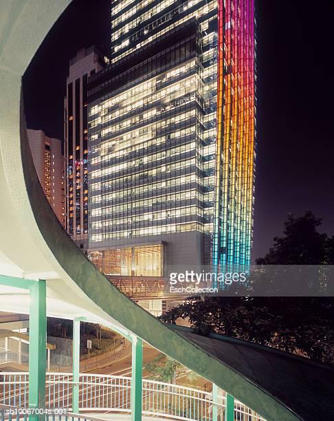 China, Hong Kong, colorful office buildings and walkway at night