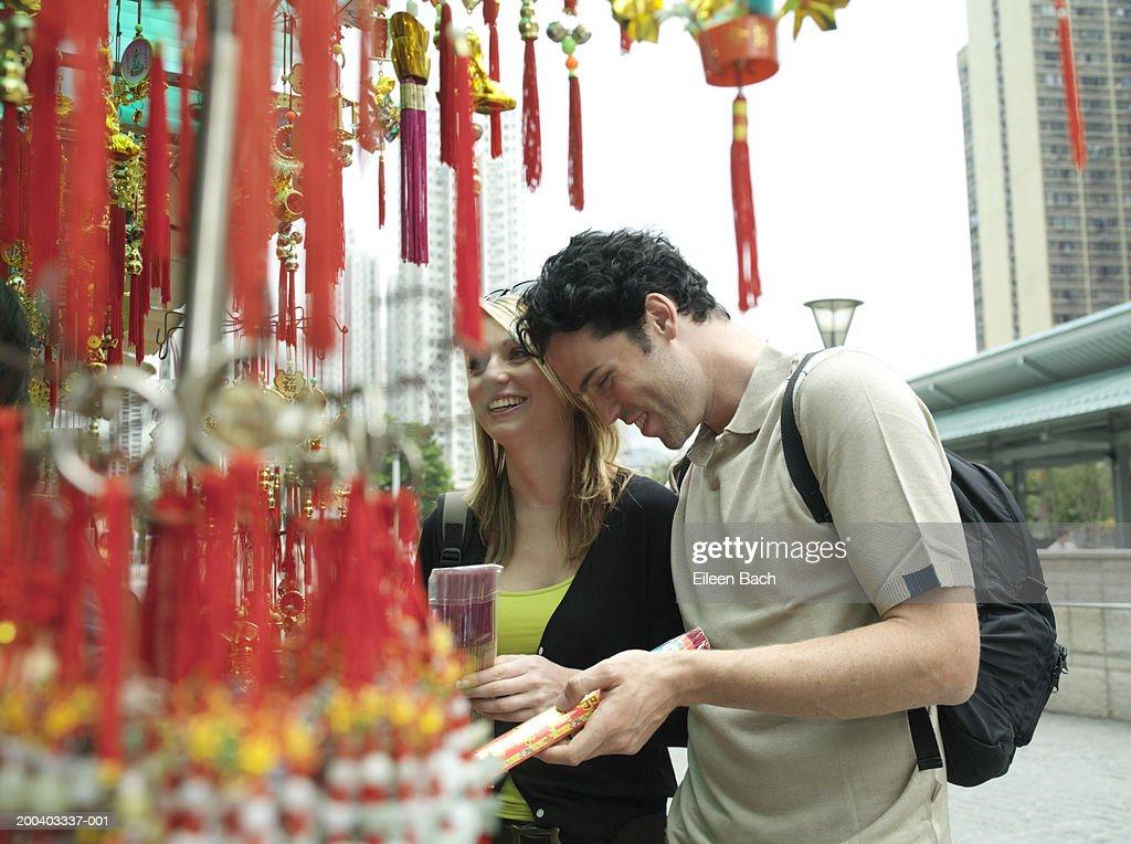 China, Hong Kong, couple looking at incense by Po Lim Temple : Stock Photo