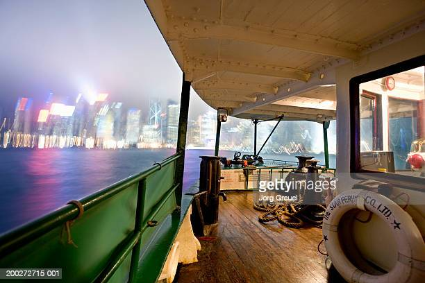 china, hong kong harbour, view from ferry, night (blurred motion) - star ferry stock pictures, royalty-free photos & images