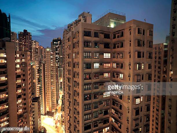 China, Hong Kong, illuminated apartment blocks at dusk
