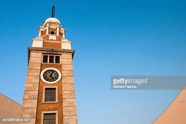 China, Hong Kong, Kowloon, Tsim Sha Tsui, Old clock tower, low angle view