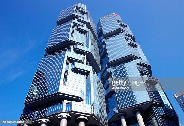 China, Hong Kong, Lippo Centre twin towers, low angle view
