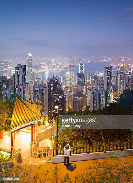 China, Hong Kong, people in front of skyline