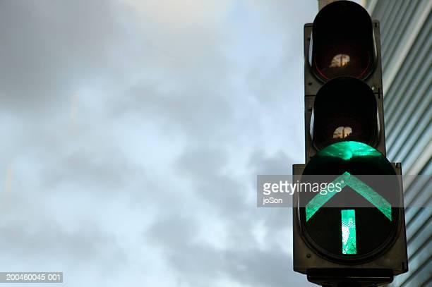 China, Hong Kong, traffic light displaying green arrow, close-up