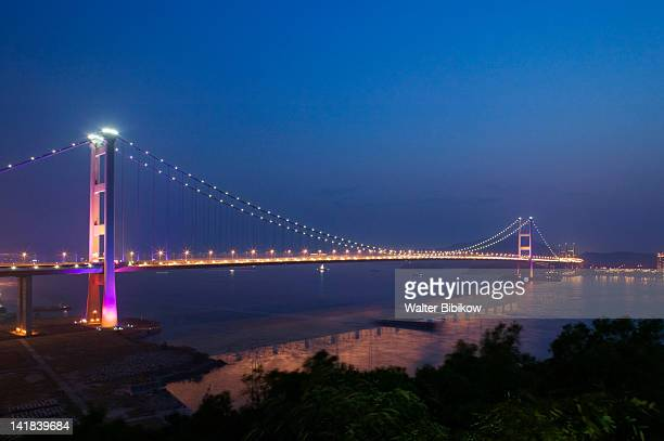 China, Hong Kong, Tsing Ma Bridge, part of the Lantau Link, connects Tsing Yi Island with Lantau Island via Ma Wan Island, built 1997 at night