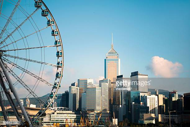 china, hong kong, view to big wheel, central plaza and other skyscrapers - wanchai stock photos and pictures