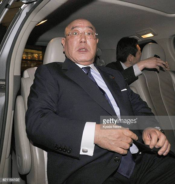 BEIJING China Isao Iijima an adviser to Japanese Prime Minister Shinzo Abe gets into a car after he arrived at Beijing airport on May 17 following a...