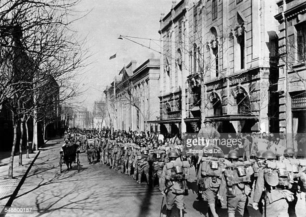 China : Japanese occupation of Manchuria following the Mukden Incident on Sept 18, 1931 Japanese infantry entering a city - November / December 1931...