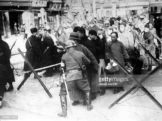China : Japanese occupation of Manchuria following the Mukden Incident on Sept 18, 1931 Japanese soldiers searching Chinese travellers in Manchuria...