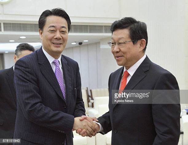 BEIJING China Japanese trade minister Banri Kaieda and Chinese Commerce Minister Chen Deming shake hands before their meeting in Beijing on July 18...