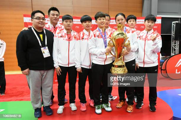 China Junior Badminton Team seen with the trophy of of the 2018 World Junior Mixed Team Championship. The World Junior Mixed Team Badminton...