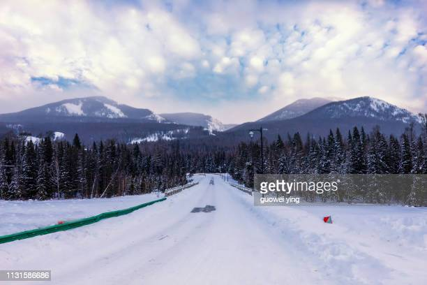 china kuitun snow mountain, xinjiang, china - 雪 stock pictures, royalty-free photos & images