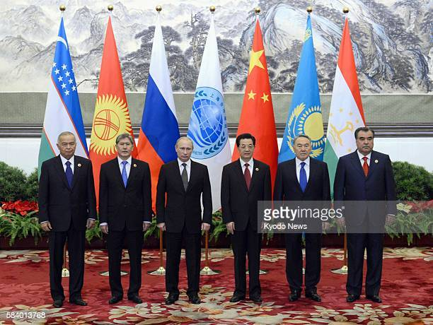 BEIJING China Leaders of China Russia and four Central Asian nations pose for photos at Beijing's Great Hall of the People on June 6 prior to a...