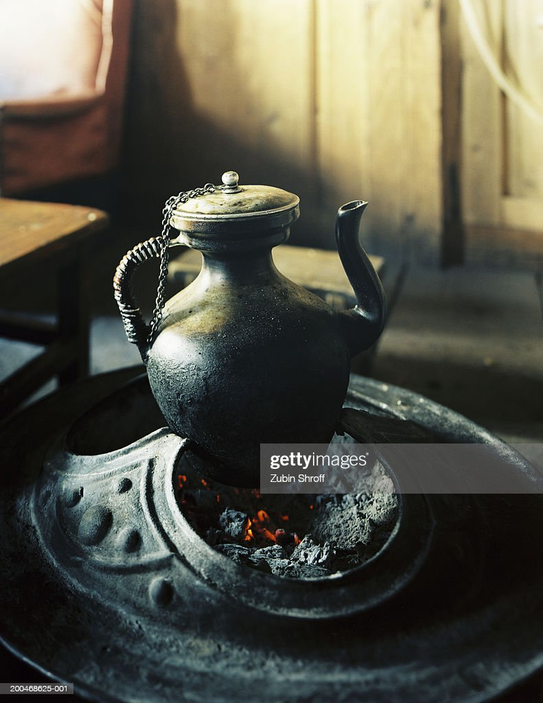 China, Liutongjiang, kettle on open fire in Tibetan home : Stock Photo