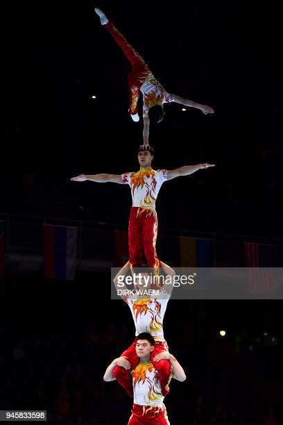 China Men's Group Fu Zhi Pei Guo Jiang Heng Zhang Junshuo perform on the first day of the 26th edition of the World Championships Acrobatic...