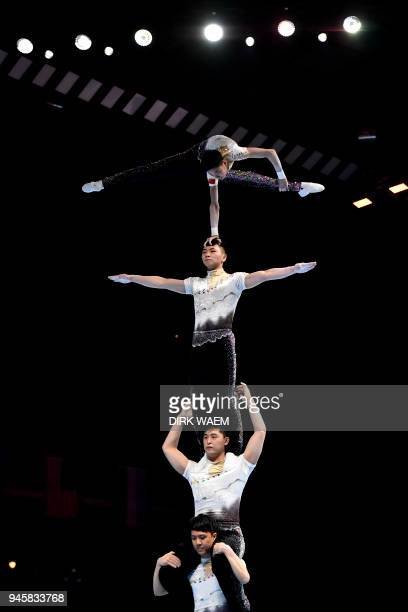 China Men's Group Li Zheng Rui Liuming Teng Zhang and Jiahuai Zhou perform on the first day of the 26th edition of the World Championships Acrobatic...