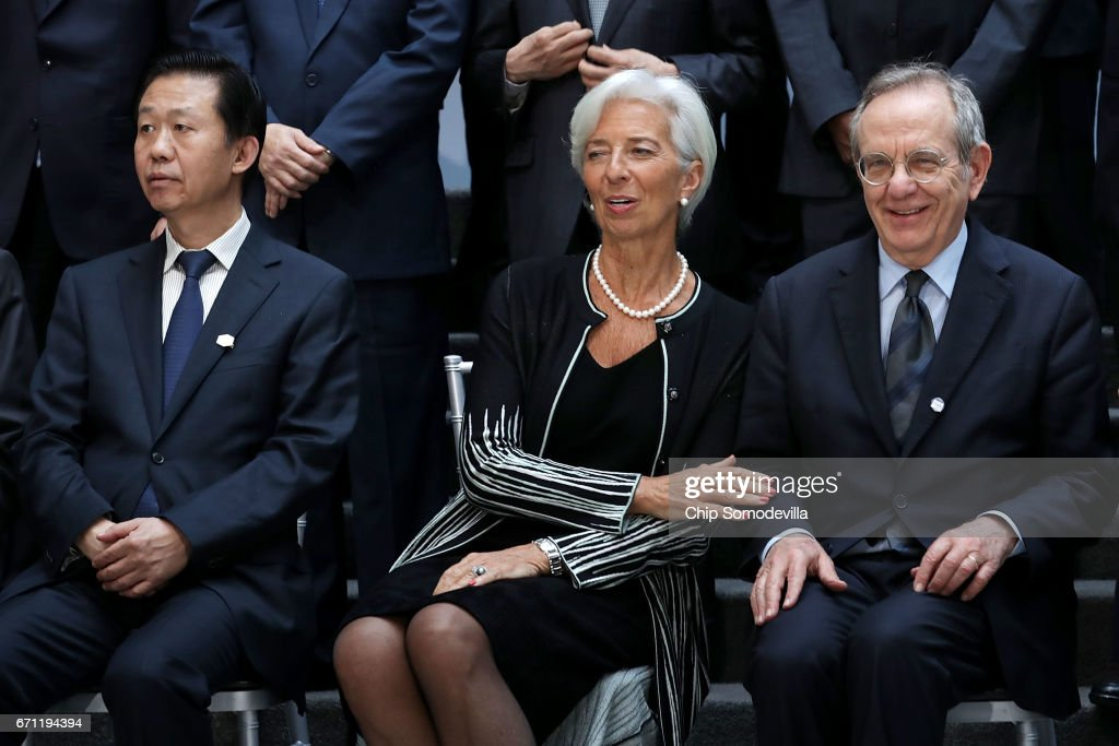 China Minister of Finance Xiao Jie, International Monetary Fund Managing Director Christine Lagarde and Italian Minister of Economy and Finances Pier Carlo Padoan prepare for a photograph with the Group of 20 Finance Ministers and central bank governors in the lobby of the IMF headquarters during the World Bank Group and IMF Spring Meetings April 21, 2017 in Washington, DC.