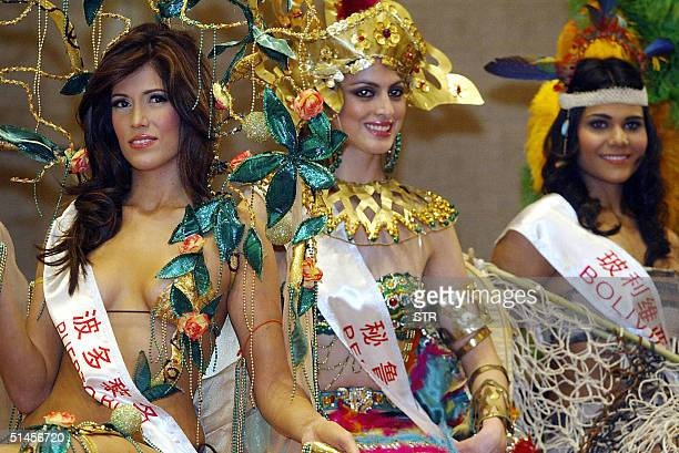 Miss Puerto Rico Meredith Herrera Miss Peru Aldana Garcia and Miss Bolivia Vanessa Moron pose in their country's traditional costumes during a press...