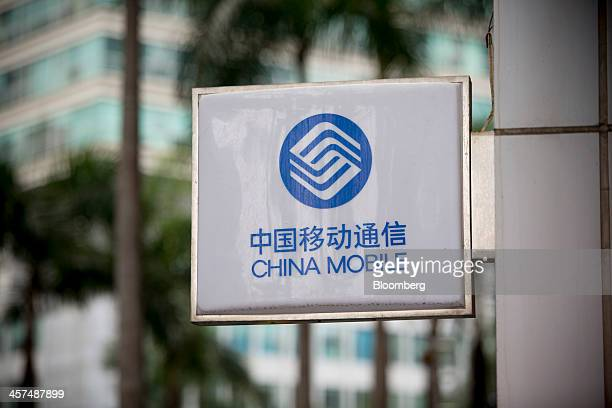 China Mobile Ltd signage is displayed outside one of the company's stores in the Futian district of Shenzhen China on Tuesday Dec 17 2013 Data on...