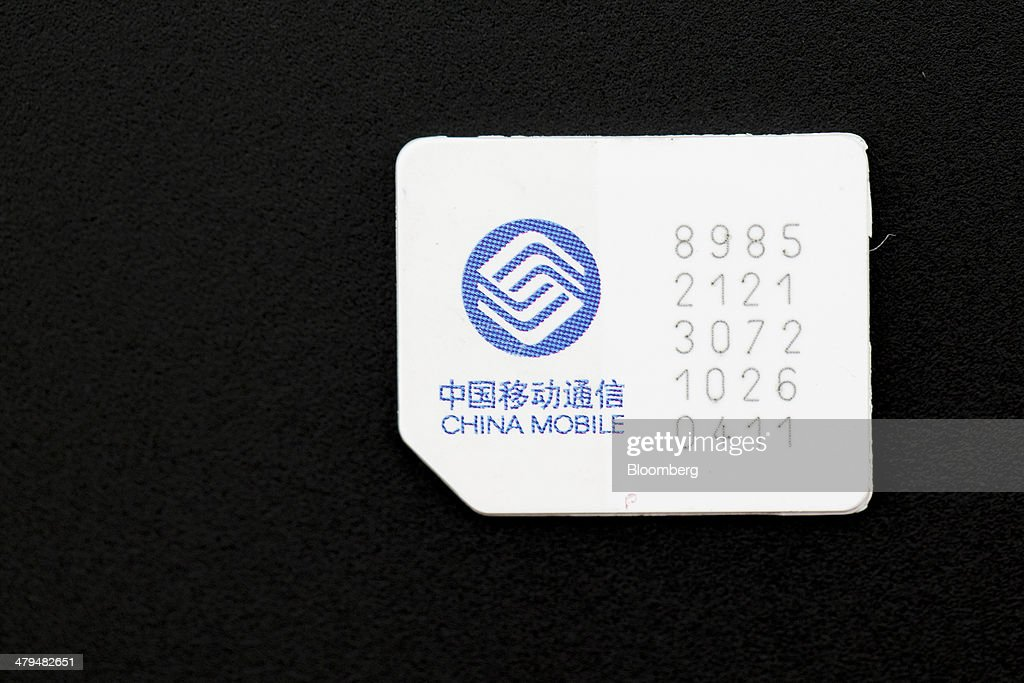 A China Mobile Ltd  SIM card is arranged for a photograph at