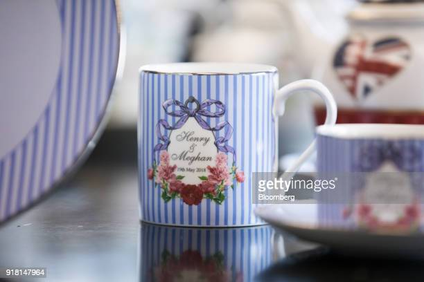 A china mug to commemorate the wedding between Henry Windsor and Meghan Markle stands on display at Halcyon Days Ltd's factory in StokeonTrent UK on...