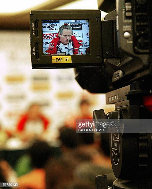 China national coach Arie Haan of Holland is seen through a cameraman's screen as he anwsers a question during a press conference in Guangzhou 16...