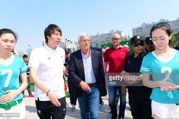China national football team manager Marcello Lippi and assistant coach Li Tie attend the opening ceremony of Litie No.8 Football Park on May 18,...