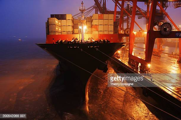 China, Ningbo Port, container ship in port, dusk