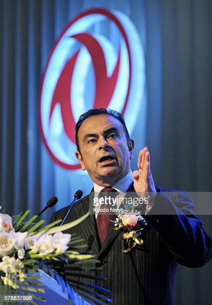 BEIJING China Nissan Motor Co President and Chief Executive Officer Carlos Ghosn speaks at a press conference in Beijing on July 26 to announce the...