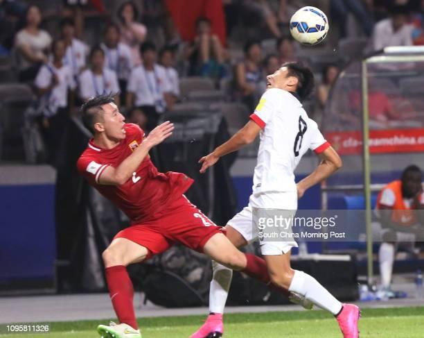 China No2 Ren Hang and Hong Kong No8 Xu Deshual in action during the 2018 FIFA World cup Qualifier at Baoan Stadium in Shenzhen 03SEP15