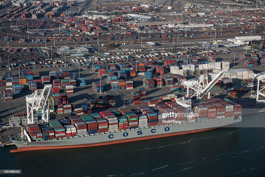A China Ocean Shipping Company (COSCO) container ship sits docked at the Port of Oakland in this aerial photograph taken above Oakland, California, U.S., on Monday, Oct. 5, 2015. With tech workers flooding San Francisco, one-bedroom apartment rents have climbed to $3,500 a month, more than in any other U.S. city. Photographer: David Paul Morris/Bloomberg via Getty Images