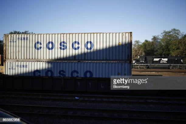 China Ocean Shipping Group Co containers sit stacked in a Norfolk Southern Corp rail yard in Danville Kentucky US on Tuesday Oct 17 2017 Norfolk...