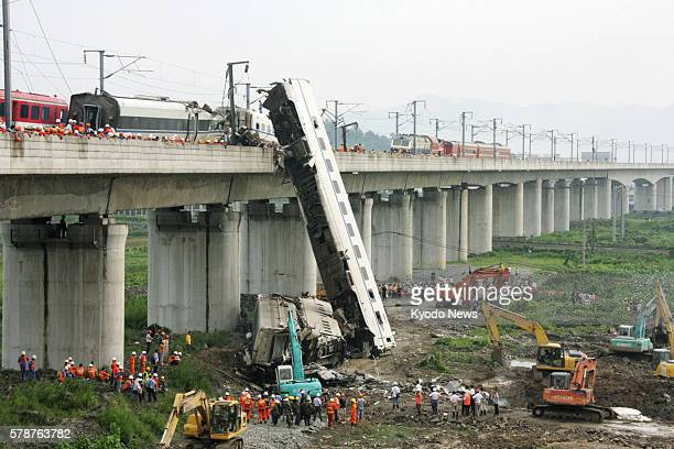 WENZHOU China Part of a bullet train is apparently seen being buried on July 24 beside a bridge that became the site of a collision of two bullet...