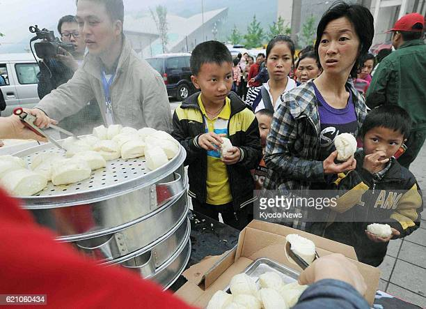 LUSHAN China People line up for food distribution in central Lushan county in Ya'an in the southwestern Chinese province of Sichuan on April 22...