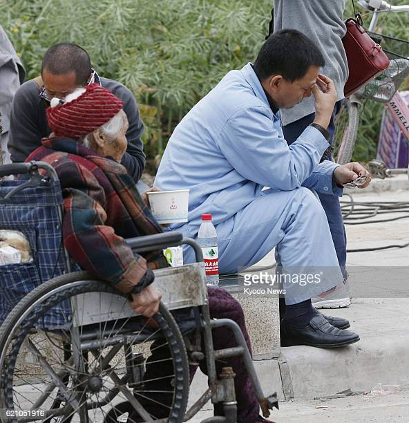 YA'AN China People sit on a roadside in Lushan county in Ya'an in the southwestern Chinese province of Sichuan on April 21 following a magnitude70...